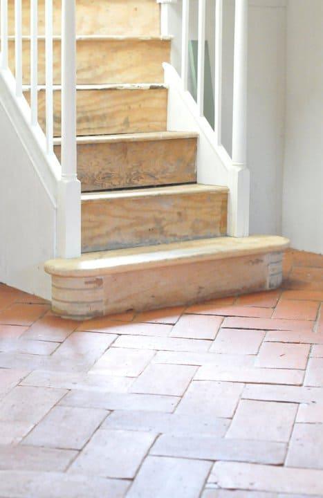 Terracotta brick tiles floors taking the bright sunlight.