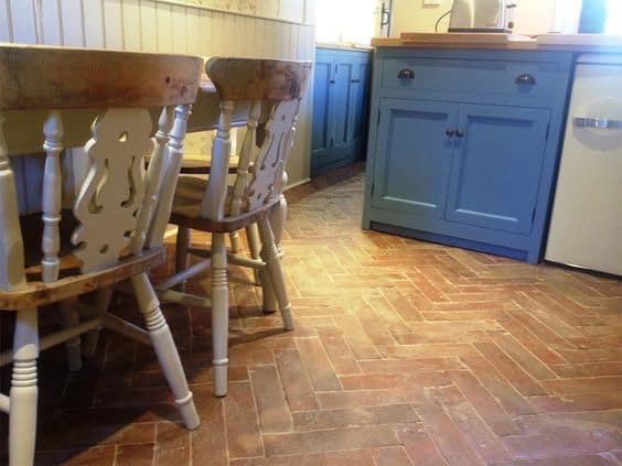 A kitchen featuring terracotta tiles flooring.