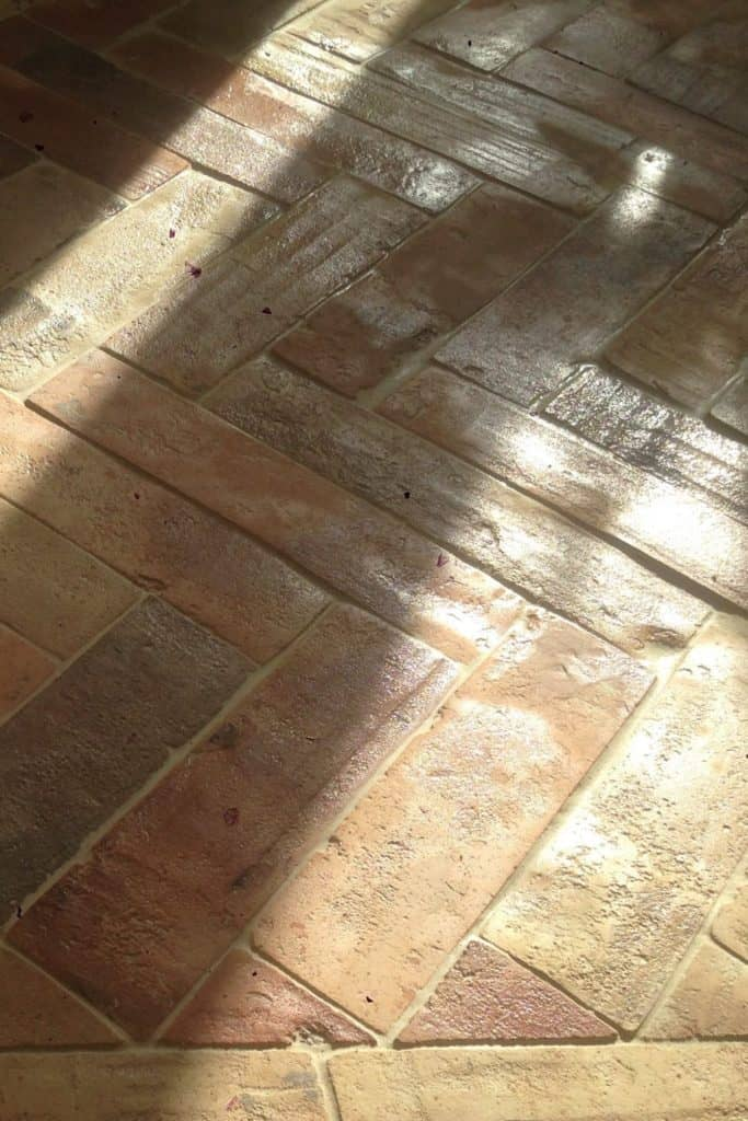 A focused shot at this terracotta brick tiles flooring.