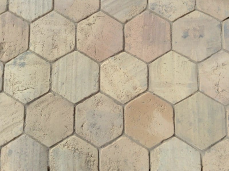 Pale hexagonal terracotta tiles flooring in a close up look.