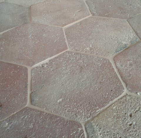 A close up look at this hexagonal terracotta tiles flooring.