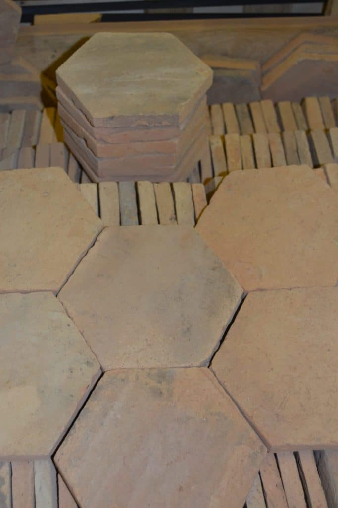 A close up look at the yet-to-install hexagonal terracotta tiles flooring.