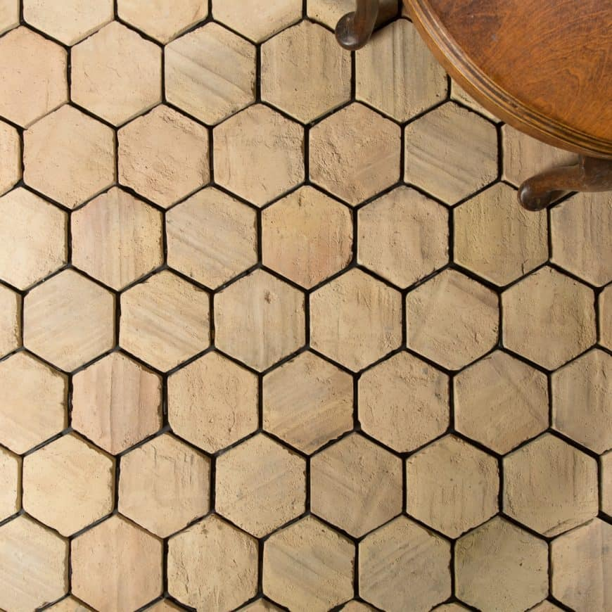 Pale hexagonal terracotta tiles flooring, close up look.
