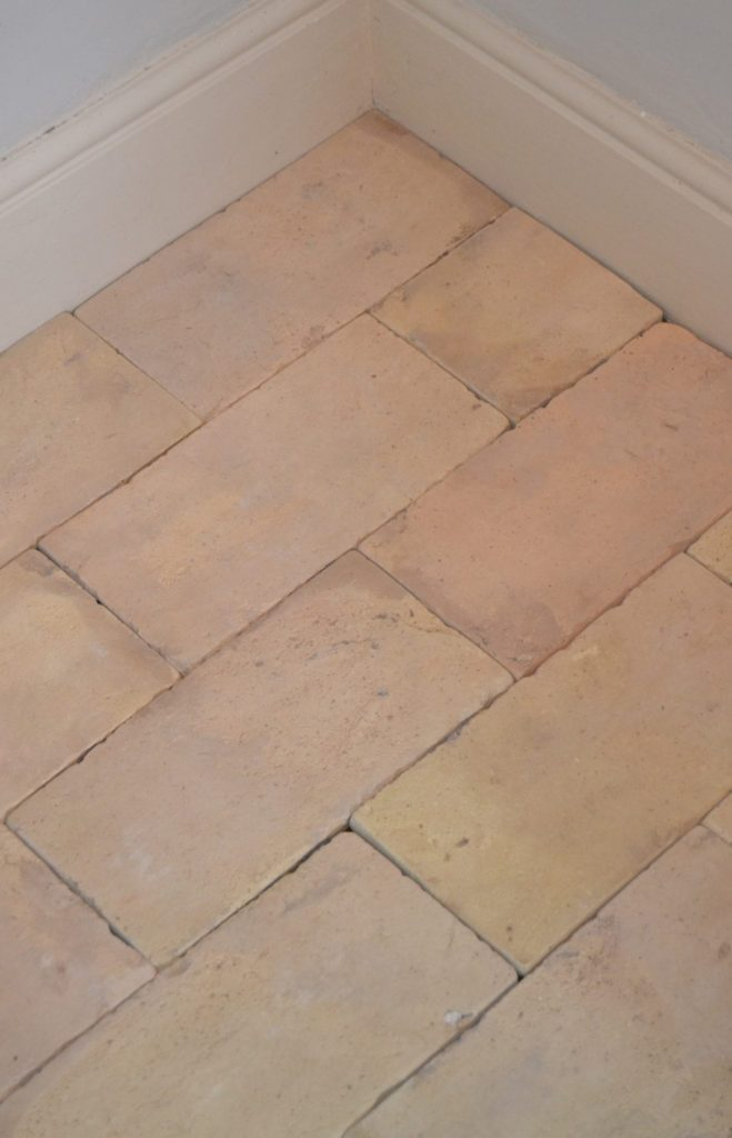 A focused shot at this pale terracotta brick tiles flooring.