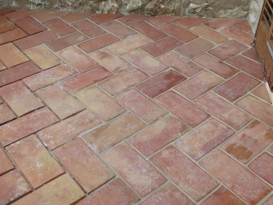 Reddish brick terracotta tiles outdoor flooring.