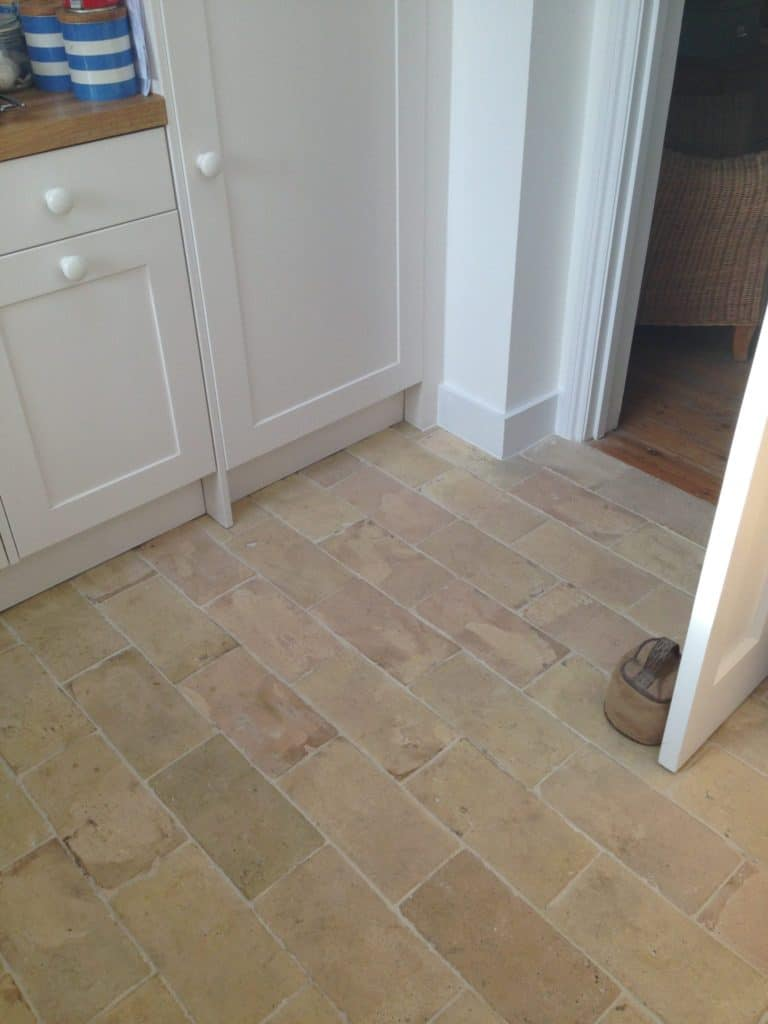 Pale brick terracotta tiles flooring.