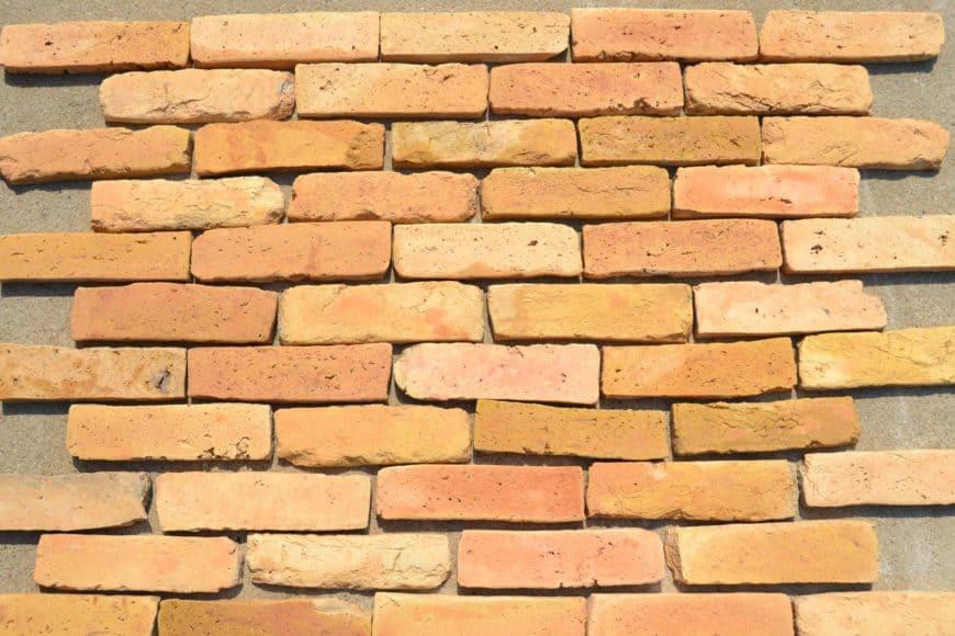 Warm terracotta brick flooring, still unassembled, focused shot.