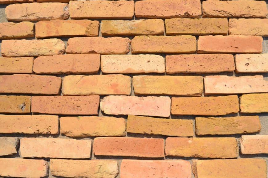 Warm terracotta brick flooring, still unassembled.