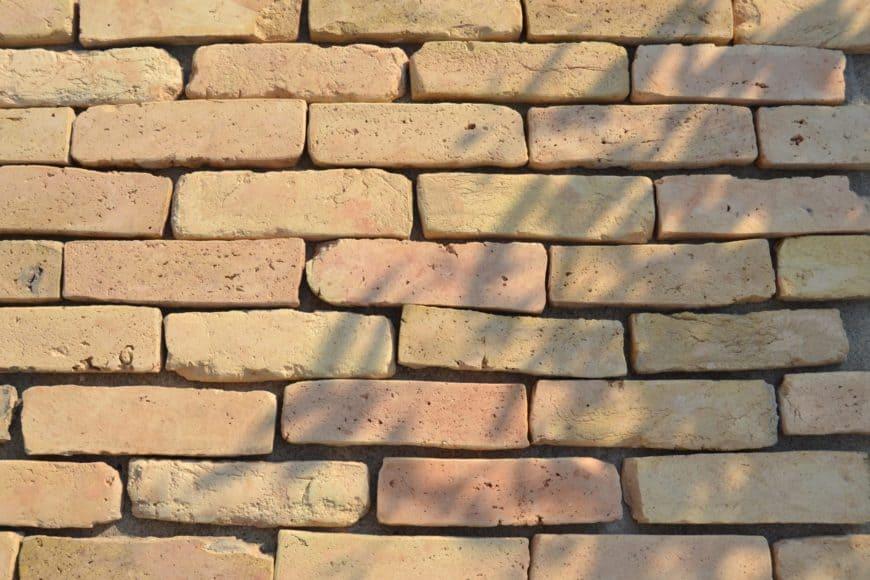Warm terracotta brick flooring under the shade, still unassembled.