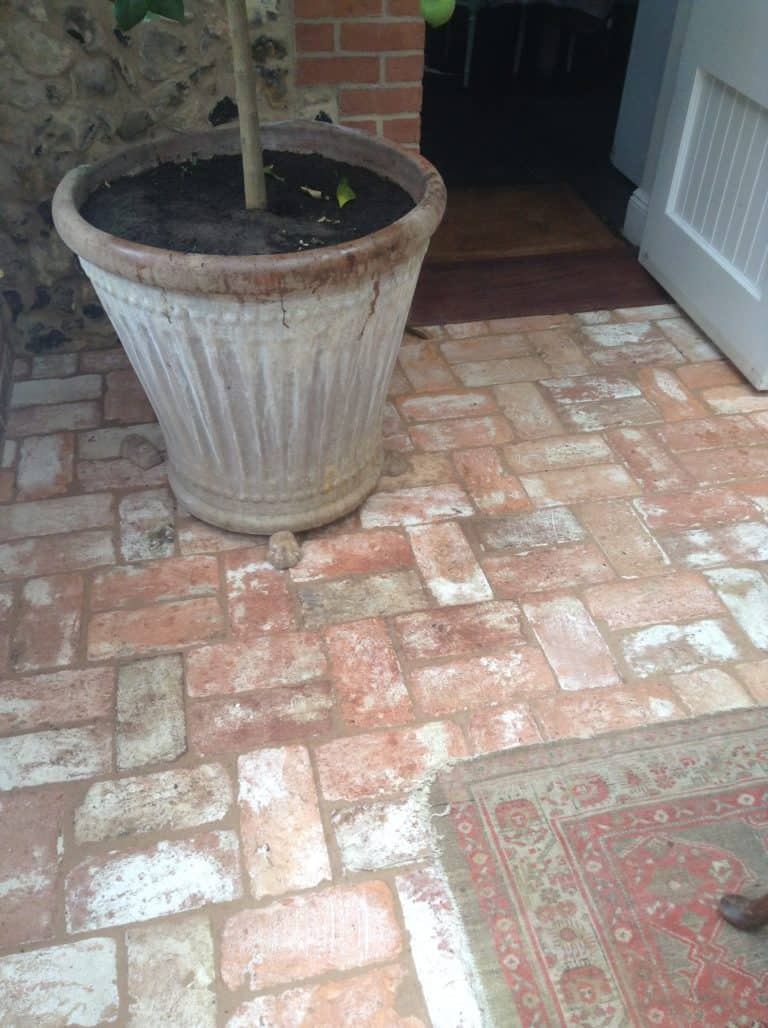 A close up look at this terracotta brick tiles flooring on the outdoor area.