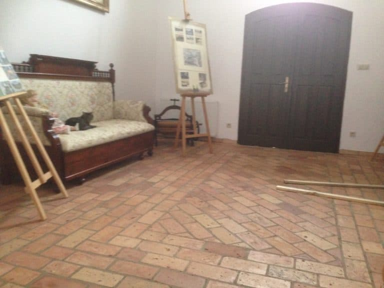 Pale brick terracotta tiles flooring in the living room.