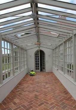 An empty hallway featuring brick terracotta tiles flooring.