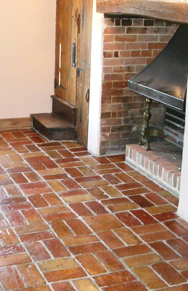 Shiny and reddish terracotta brick tiles flooring.