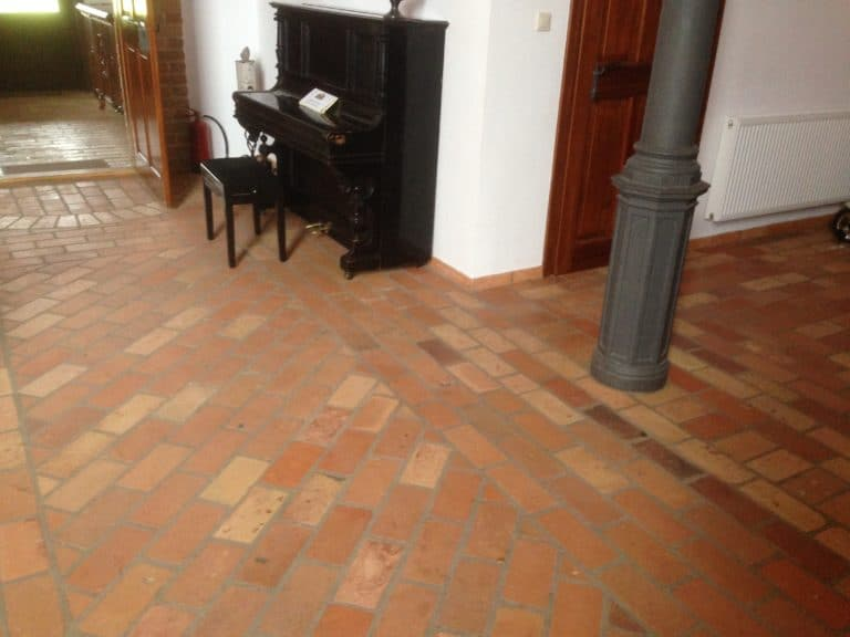Warm terracotta brick tiles flooring fully installed in this home.