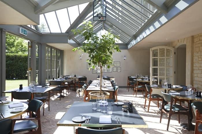 A huge dining room boasting terracotta tiles flooring.