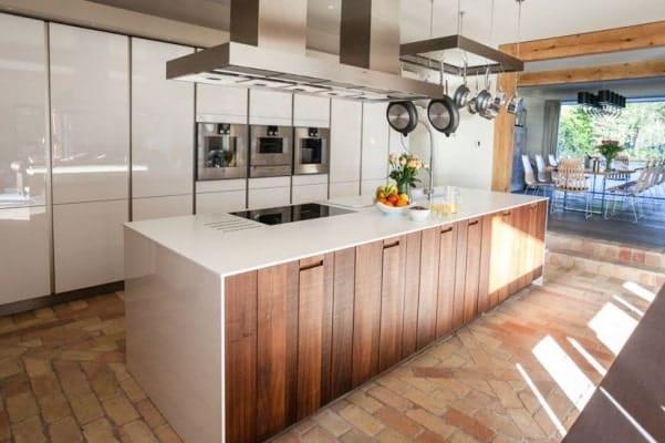 Single-wall kitchen with brick terracotta tiles flooring.