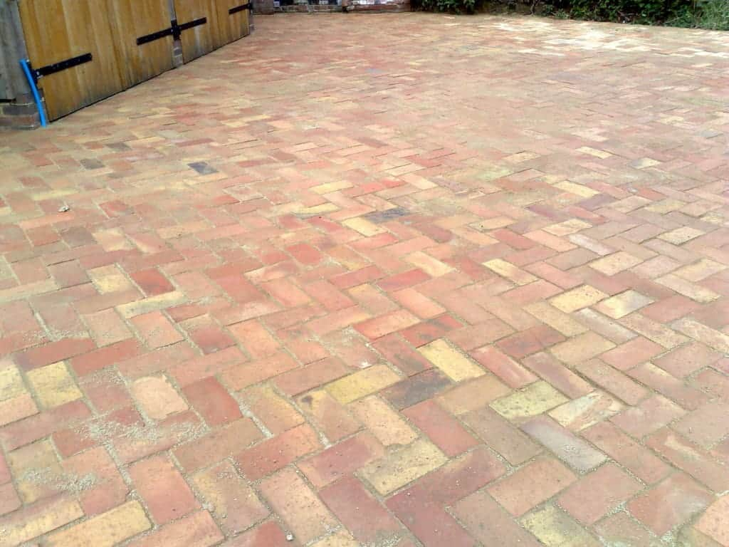 Full brick terracotta tiles ground on this home's backyard area.
