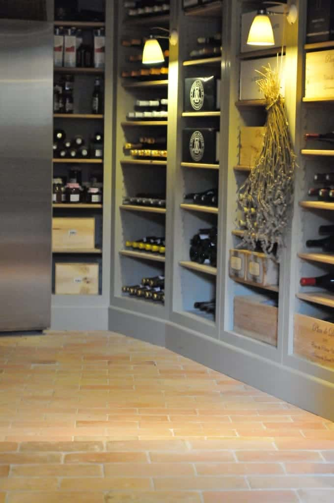 A spacious wine cellar room with terracotta brick tiles flooring.
