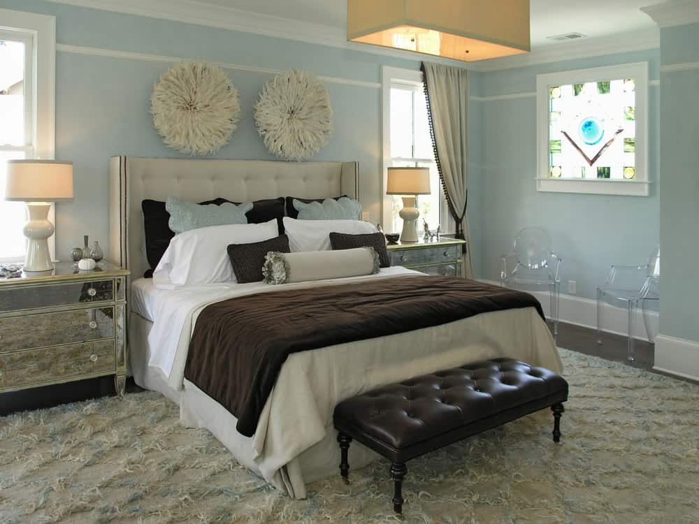 Master bedroom featuring a large rug covering the hardwood flooring. It also features sky blue walls surrounding the space.