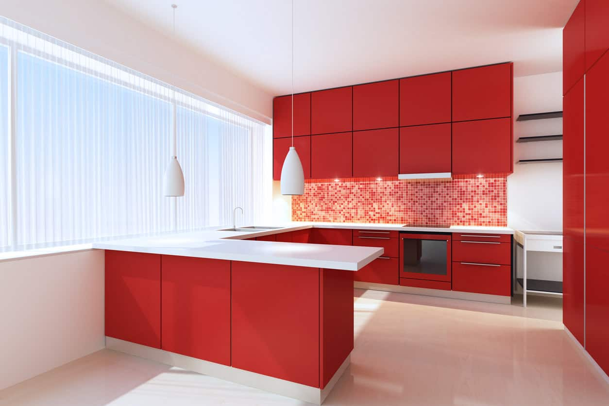 A minimalist red kitchen featuring white countertops and red kitchen counters, along with red micro tiles backsplash.