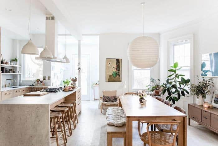 Scandinavian-style open concept interior showcasing the kitchen and dining room.