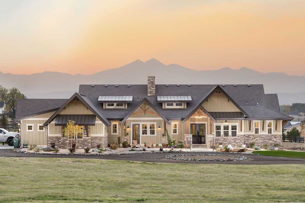 Multiple gables at varying heights reflect the mountainous surrounding. It is well complemented with a well-maintained lawn and serene landscaping.