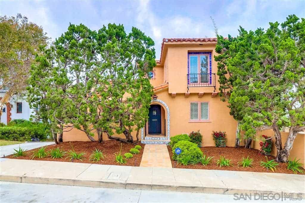 The two-story trees on this front lawn have such picturesque branches and leaves like huge bonsai trees giving a distinct character to the beige walls of the house. These are paired with <a class=
