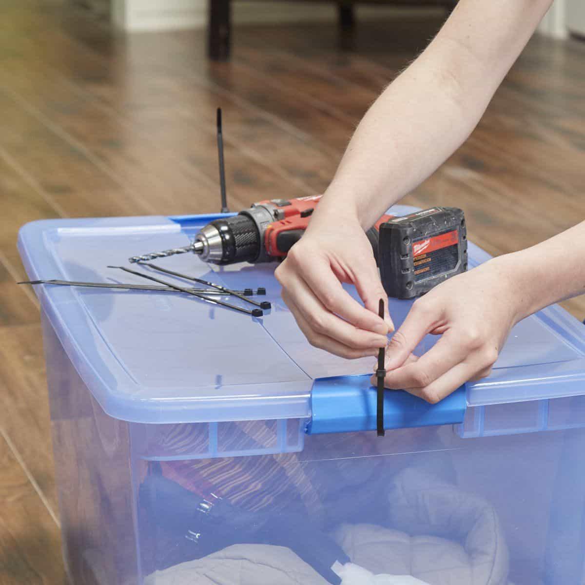 Securing zip ties to a storage bin.