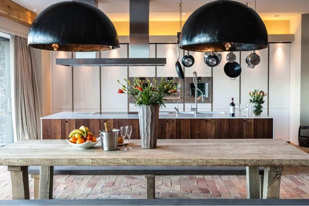 Rustic modern kitchen with terracotta brick flooring.