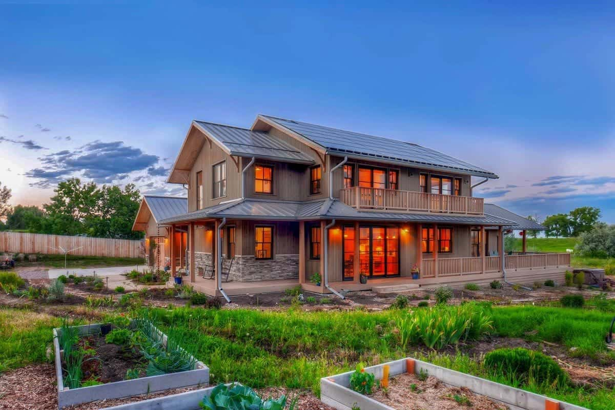 This is the side of the house that has an abundant grass lawn complemented by the rectangular planters for small separate gardens that bring color to the earthy house exterior.