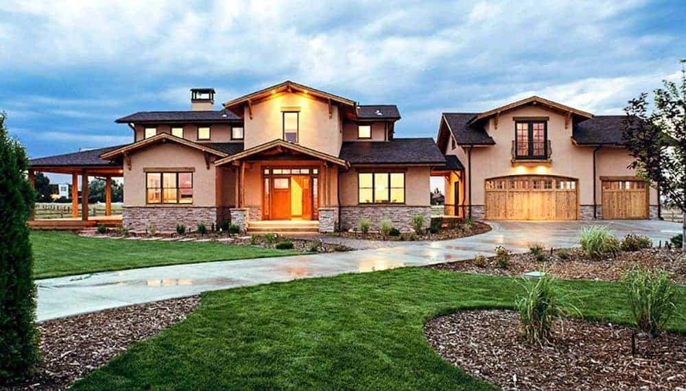 Serene landscaping enhanced with curves and beautiful plants adorn this craftsman home.