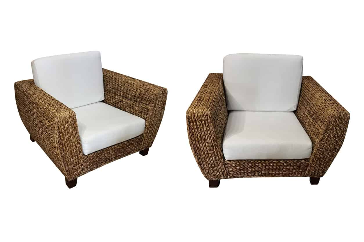 2 wicker chairs with white cushions