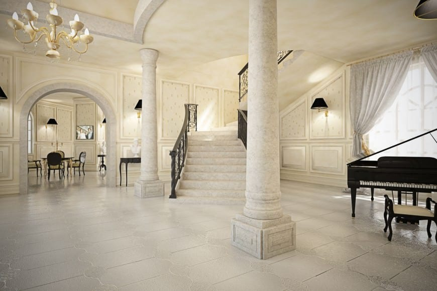 A mansion with a Romantic-style foyer featuring white elegant walls and floors, along with a black piano on the side.