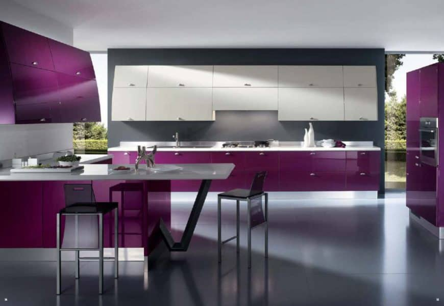 Huge modern kitchen with gray tiles flooring and purple accent kitchen counters and cabinetry. The white countertops looks absolutely classy together with the purple accent.