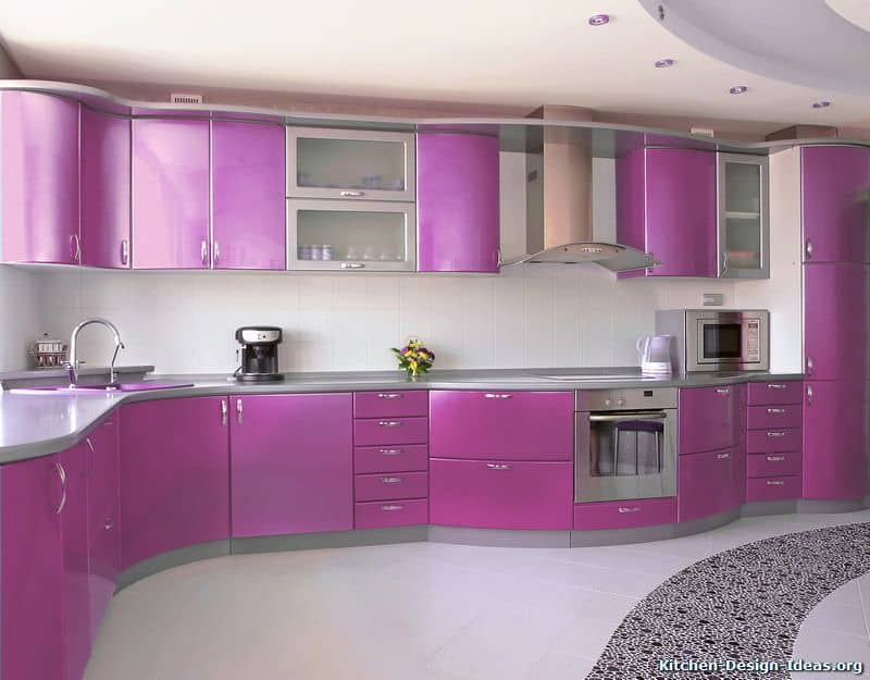 A kitchen with purple kitchen counters and cabinetry. The tiles flooring looks stylish as well.
