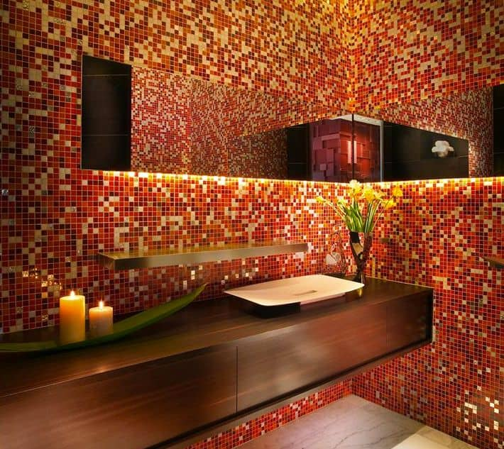 Modish master bathroom with charming micro red tiles walls and floating vanity with a vessel sink.