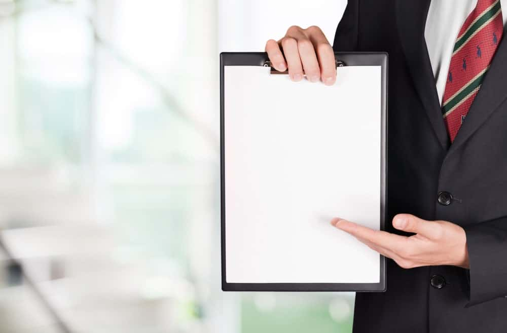 A person pointing toward a blank document