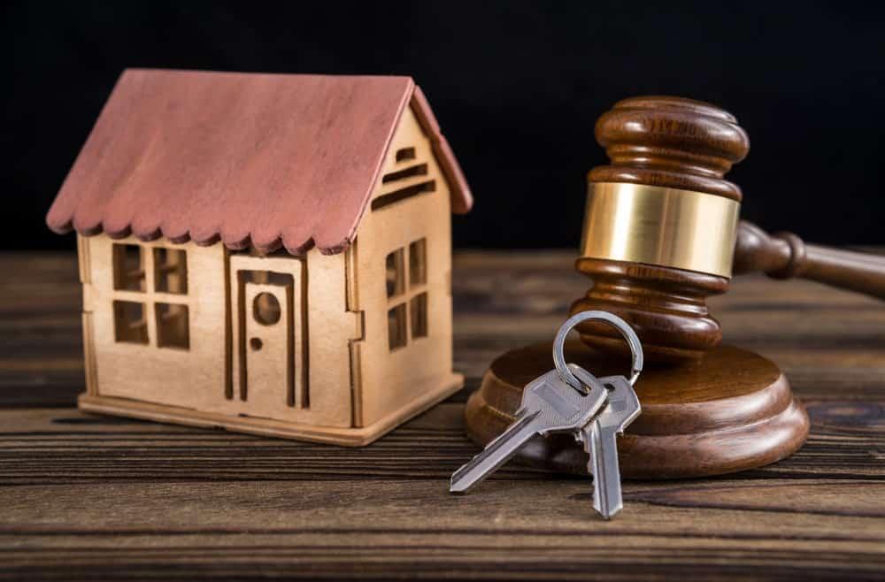 A house, a key, and a gavel