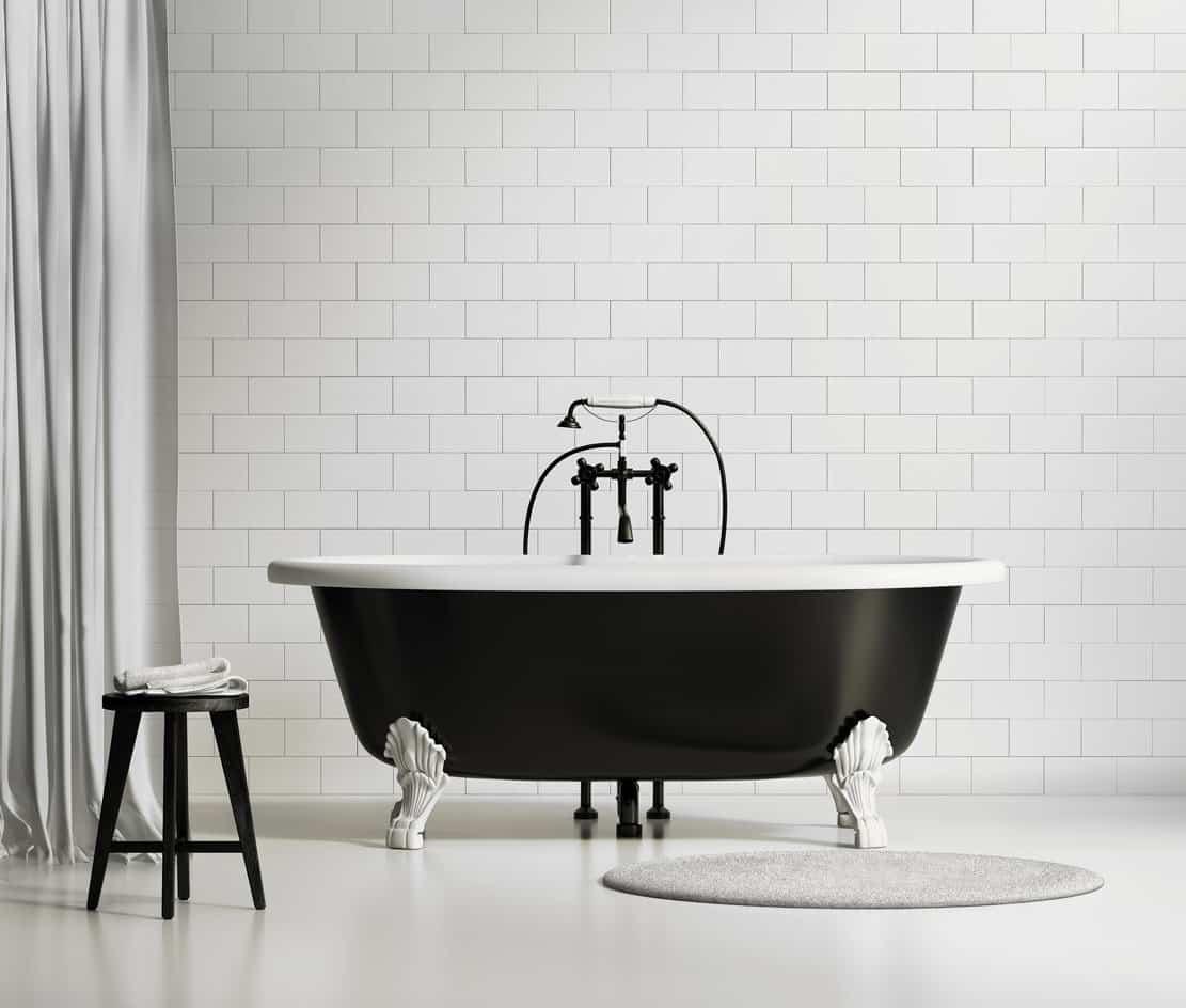 Black freestanding tub in bathroom