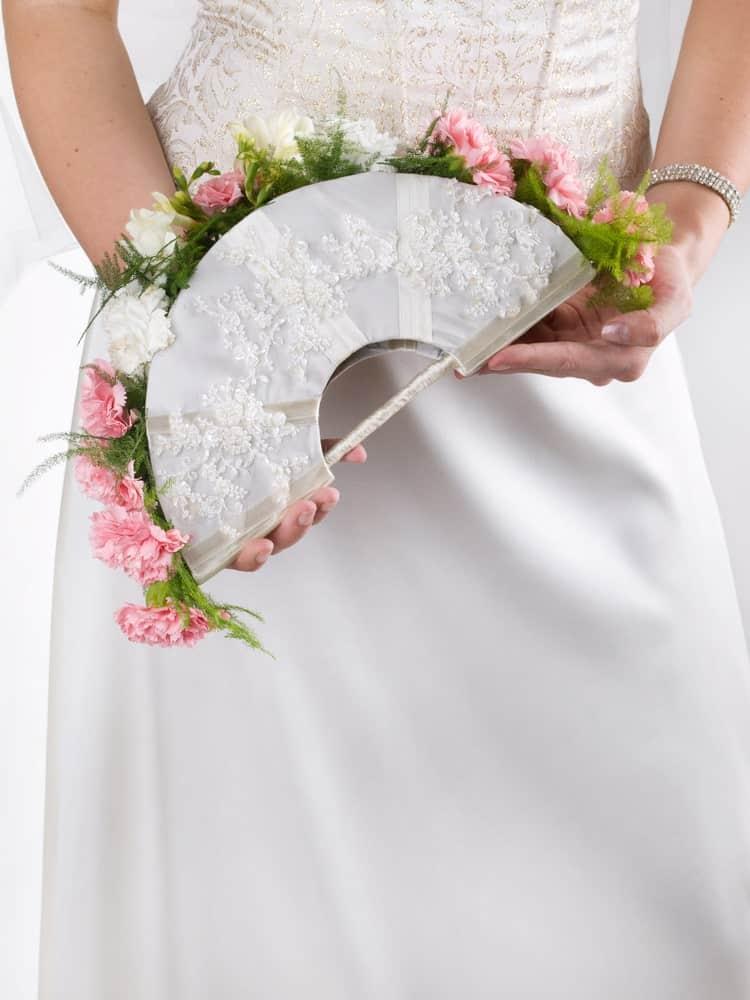 Bride holding a fan bouquet