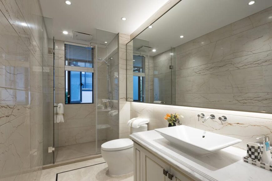 Photo of a modern bathroom with toilet, basin, vanity and shower
