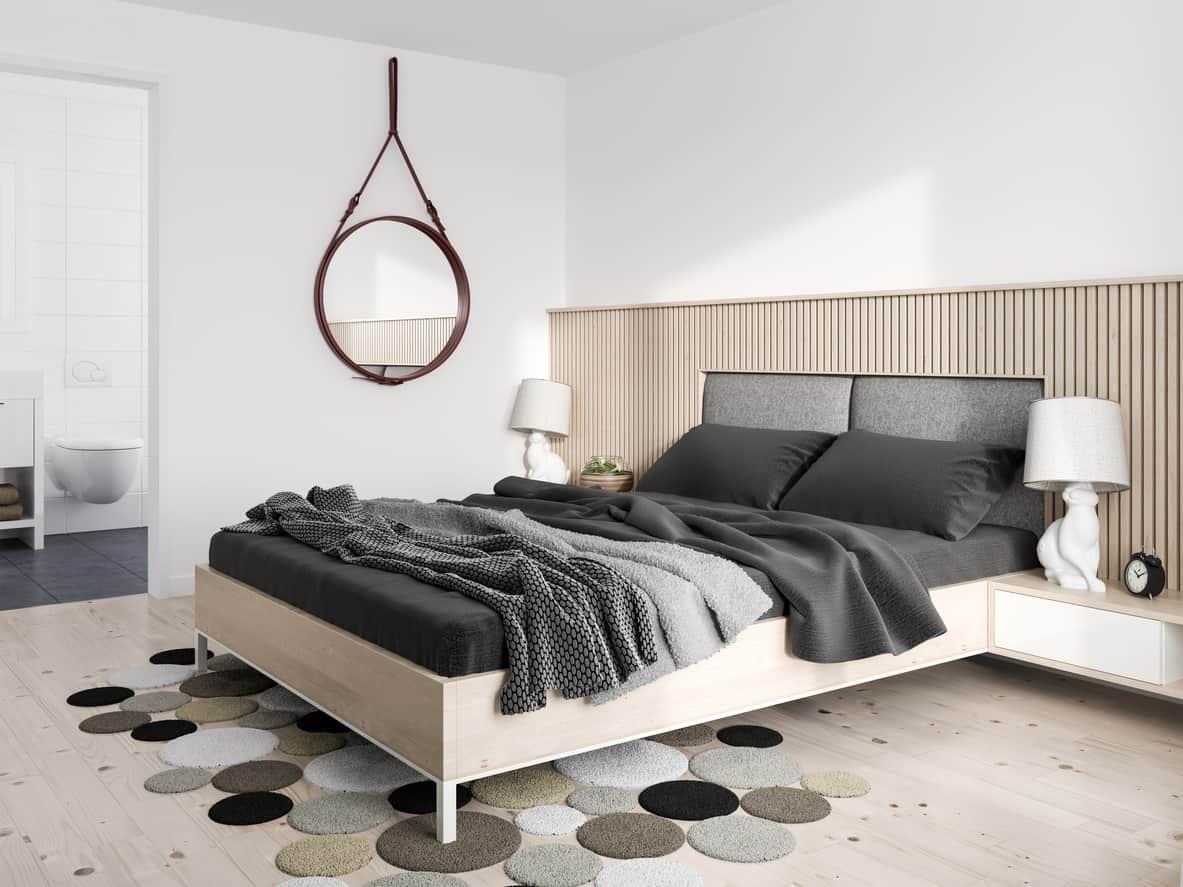 Light bedroom with black decor elements