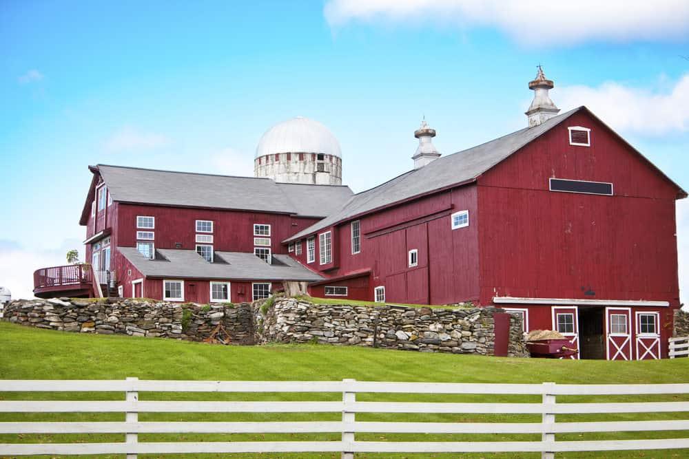 Red barndominium - big red barn turned living space