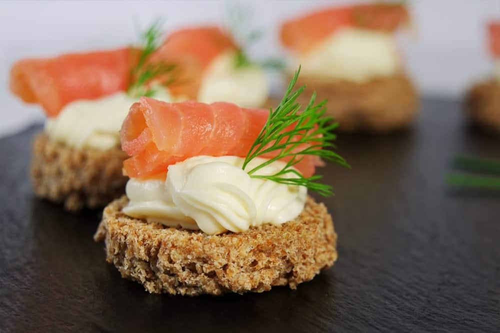 Salmon canapés on a plate.