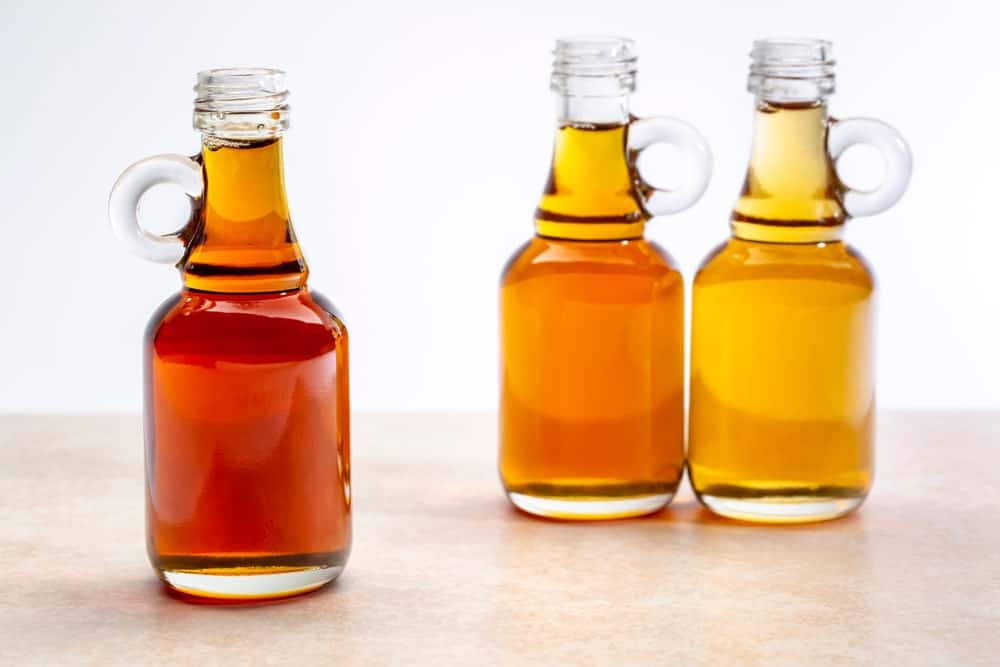 Bottles of different maple syrup grades
