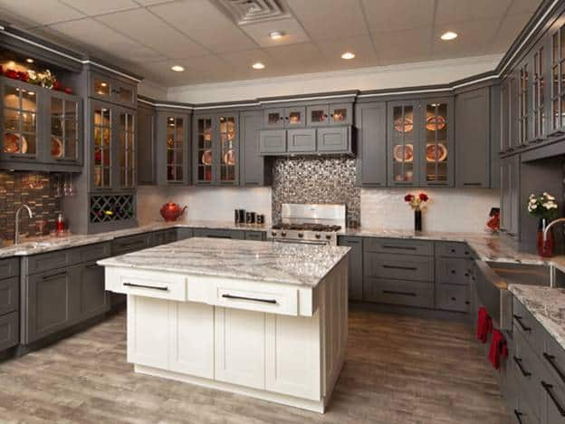 In this lovely U-shaped kitchen, you will see that the shaker cabinet design is consistent on all the gray cabinets and drawers as well as the white kitchen island with the same countertop as the peninsula.
