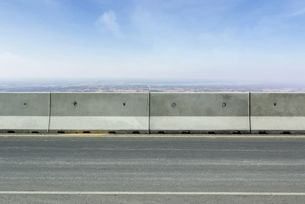 Large concrete barriers used to control traffic