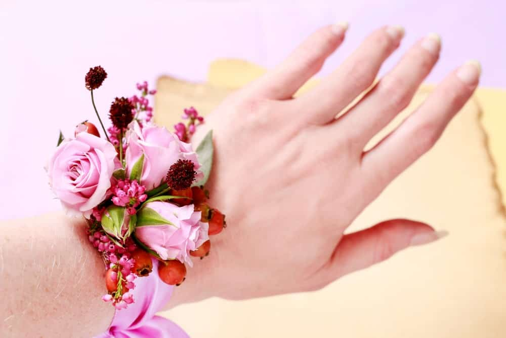 A red wrist corsage