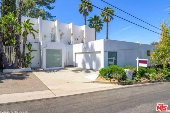 A single family contemporary home with a white exterior located in Hollywood Hills.