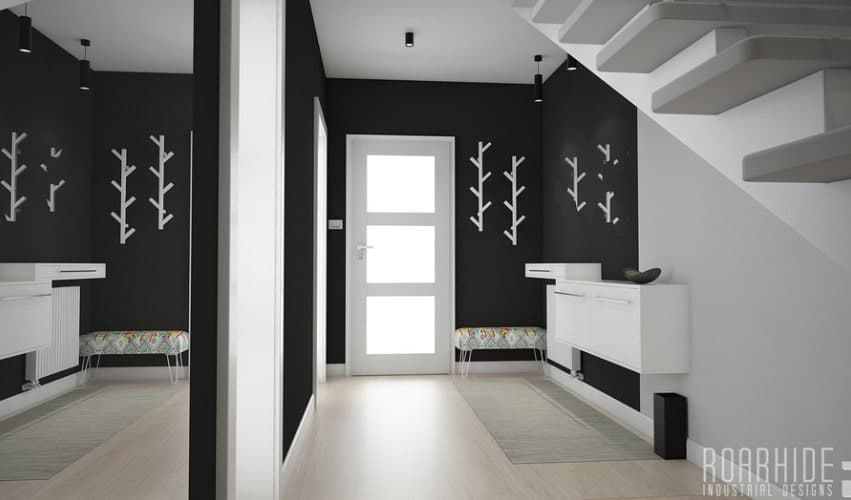A handsome black and white foyer featuring stylish wall decors.